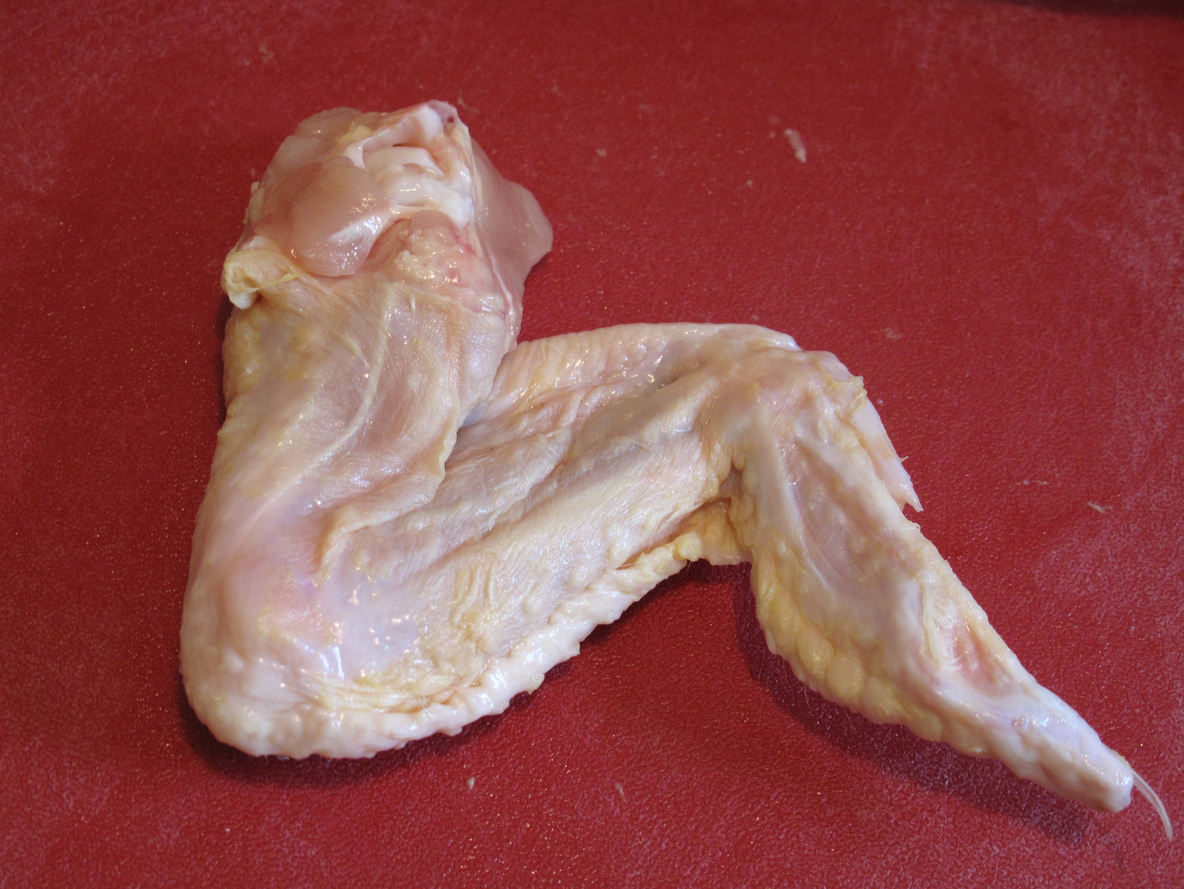 A full chicken wing (bottom view shown here) will have two distinct joints.