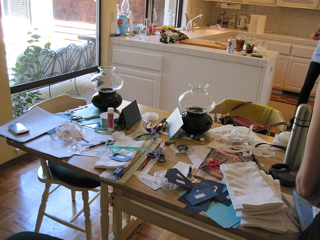 It's T-minus four hours to the party and the kitchen is a mess! On the table? The fixings for homemade place cards.