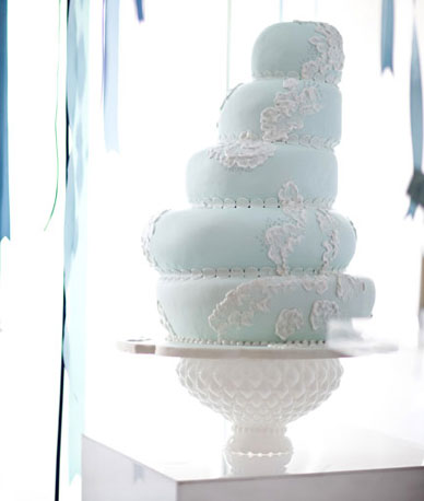 With its ornate base, this hobnail milk glass pedestal is quite the showstopper, and yet it still highlights the main attraction —the cake. Photo by Caroline Tran via Source