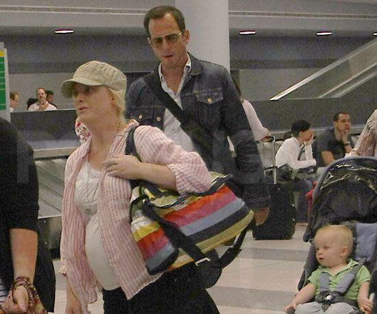 Slide Picture of Amy Poehler and Will Arnett With Archie in New York