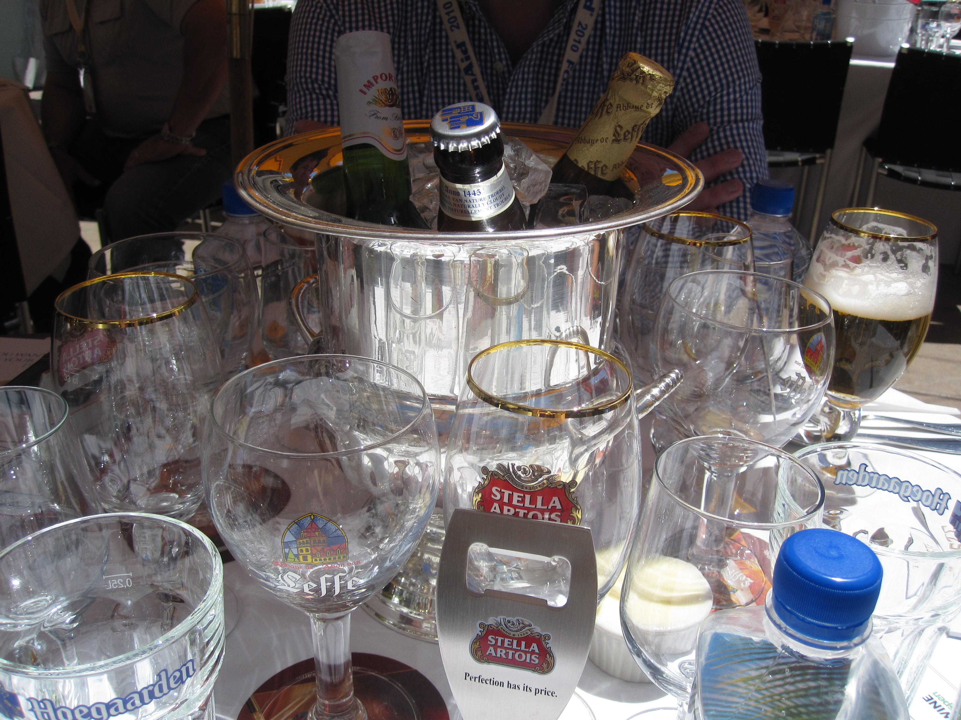 Instead of having a bar, ice buckets were placed in the middle of each table. As a party favor, guests were given a Stella bottle opener. If you wanted a cold beer, you simply opened one at the table! It was fun.