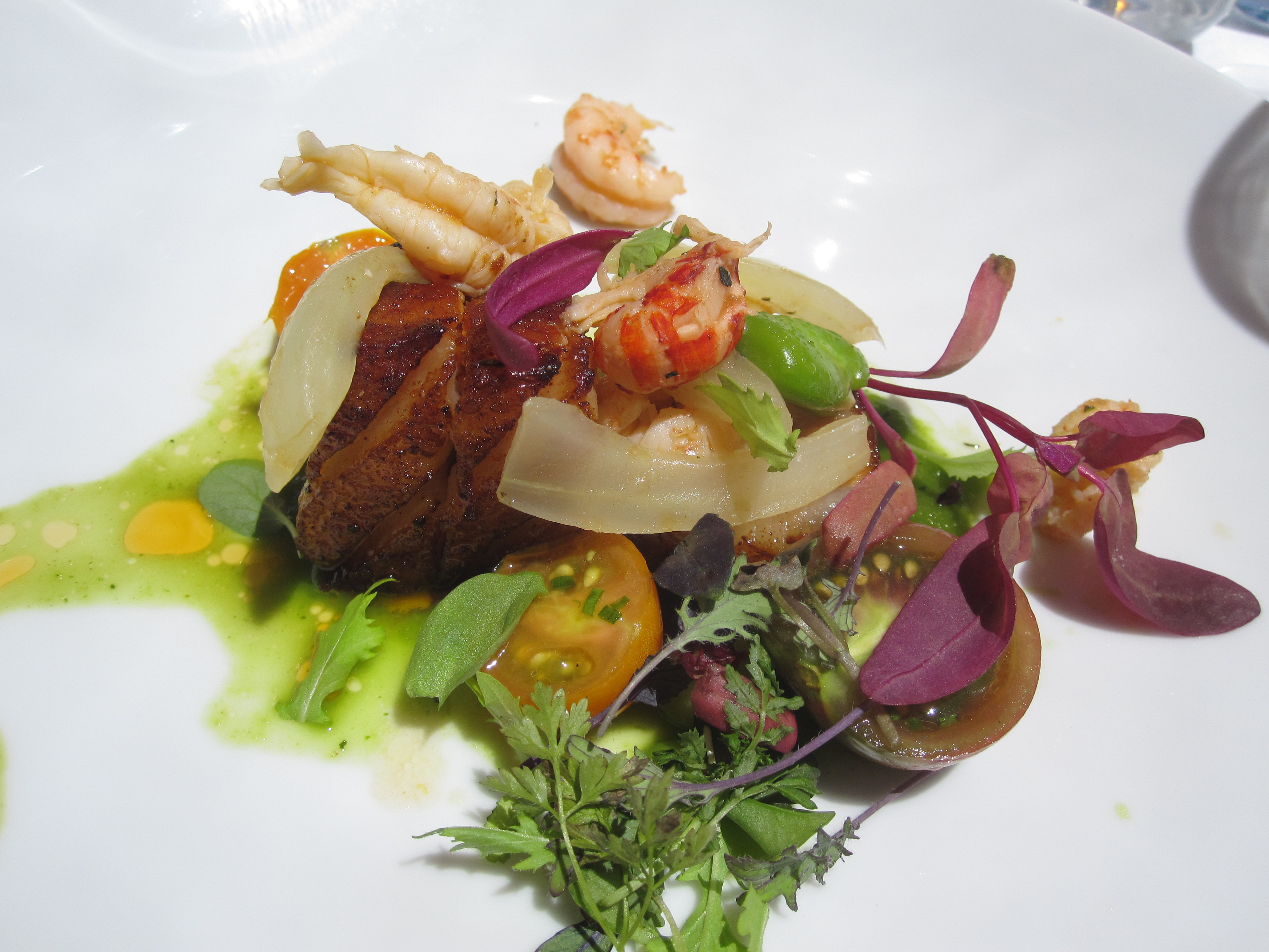 Cane lacquered Berkshire pork belly was topped with Louisiana crawfish tails that tasted a lot like shrimp. It was an alternative but tasty take on surf and turf.