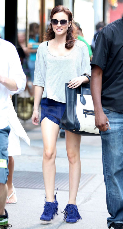 Leighton's cool blue-hued outfit is unique, yet casual. Her two-tone oversized Loewe bag is rad, but those cobalt blue fringe shoes are killer!