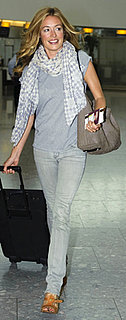 Cat Deeley Wearing Gray Tee and Jeans at Heathrow