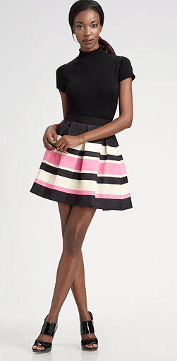 A pleated circle skirt is way more fresh these days than those played-out, skin-tight bandage skirts. Shop this look.