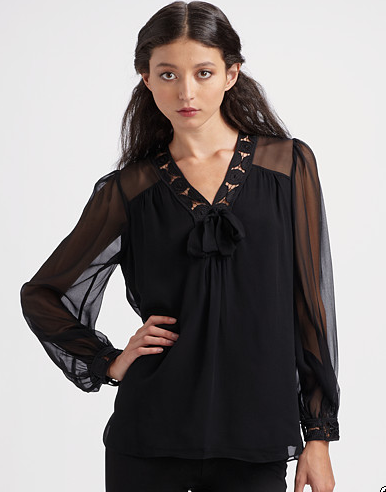 If you're not into full-frontal sheer, see-through sleeves are a subtly chic alternative. Shop this look.