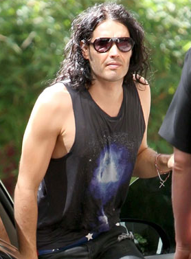 Pictures of Russell Brand Who Was Arrested and Charged With Battery Before Being Bailed After Photographer Scuffle at LAX