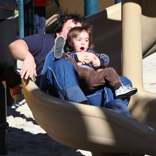 Guess Who's Taking a Ride Down a Slide?