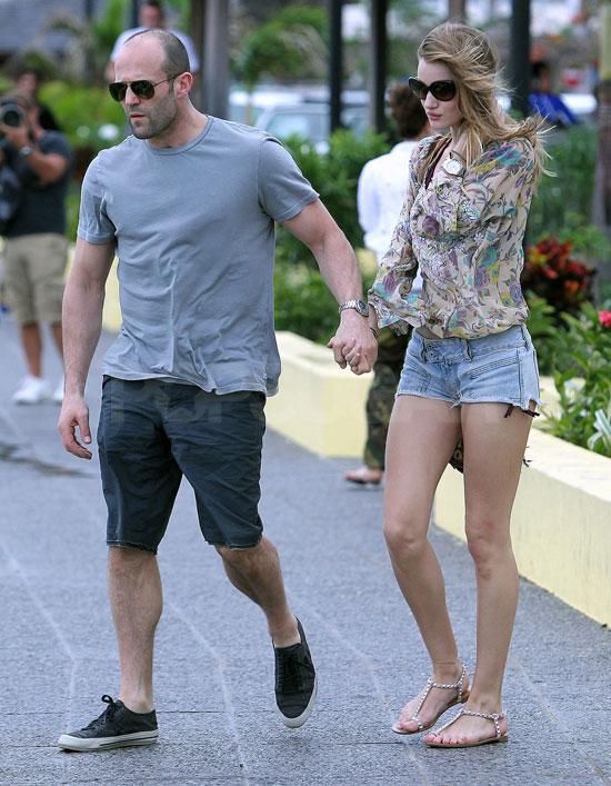 Rosie Huntington-Whiteley and Jason Statham walking with