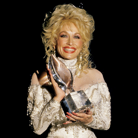 For the 1988 People's Choice Awards, Dolly debuted the choppy bangs and short crown layers that she's been wearing ever since.