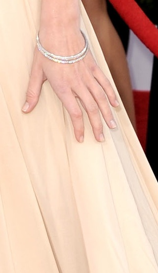 We love the choice of a clean manicure and a couple of diamond Martin Katz bangles.