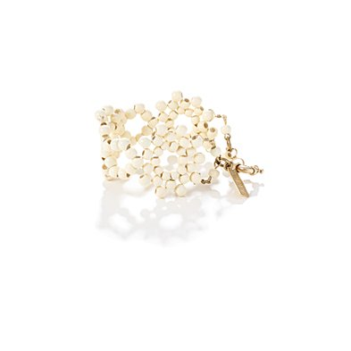 Think of this little bracelet as you would a pair of lacy white shorts or top — it's that ultrafeminine piece to play opposites against your structured, tougher components.  Madewell Morning Dew Bracelet ($45)