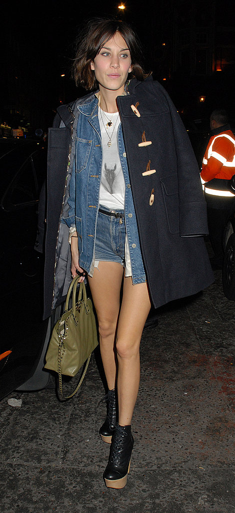 Alexa Chung showed off denim on denim styling with a pair of platform booties.