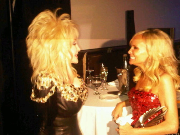 "Kristin Chenoweth with her ""idol"" Dolly Parton. Both looking sparkly."