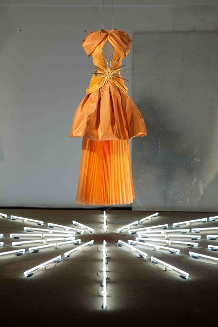 Cantaloupe Pleated Silk, Draped Silk Georgette, and Taffeta GownwithGold Ray Belt