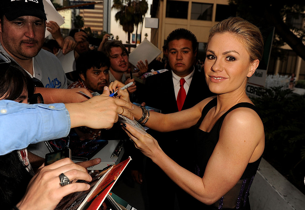 Anna Paquin signed photos for fans outside the True Blood premiere.