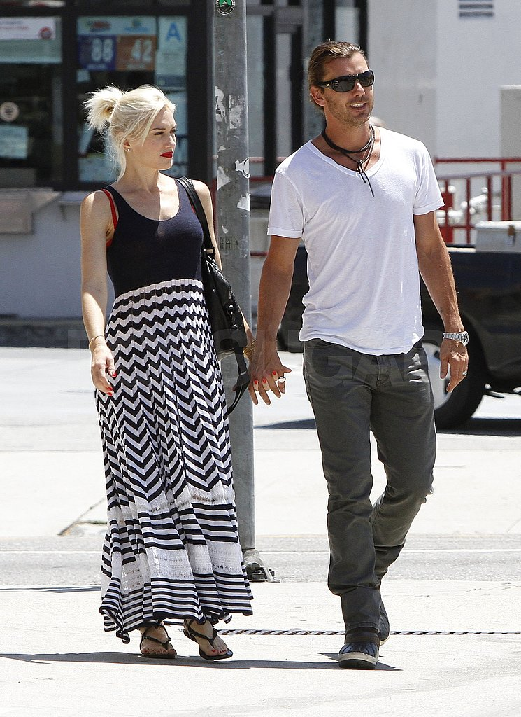 Gwen Stefani and Gavin Rossdale hold hands.