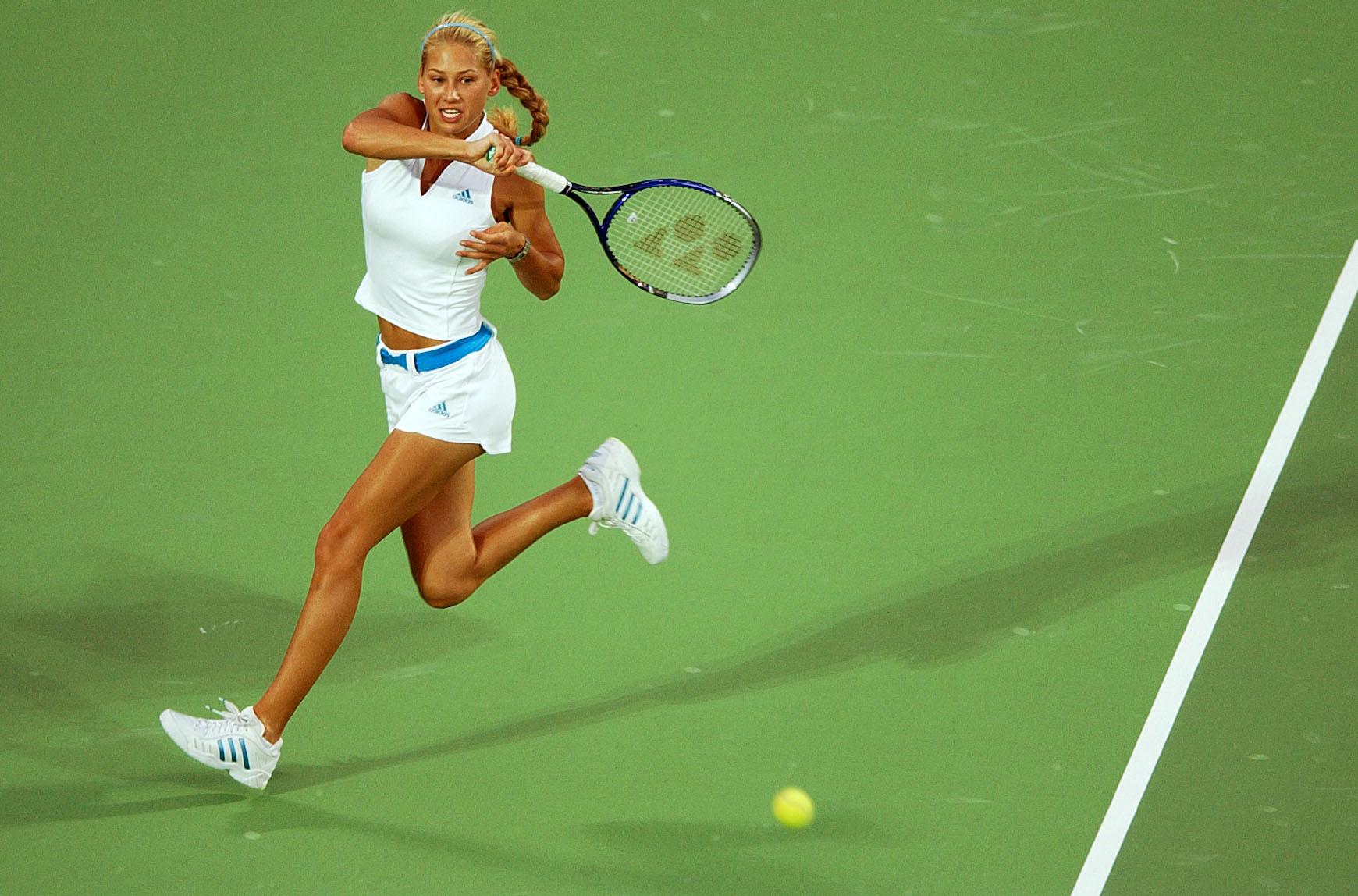 Anna Kournikova displayed her favorite designer brand and colors in an all Adidas tennis attire.