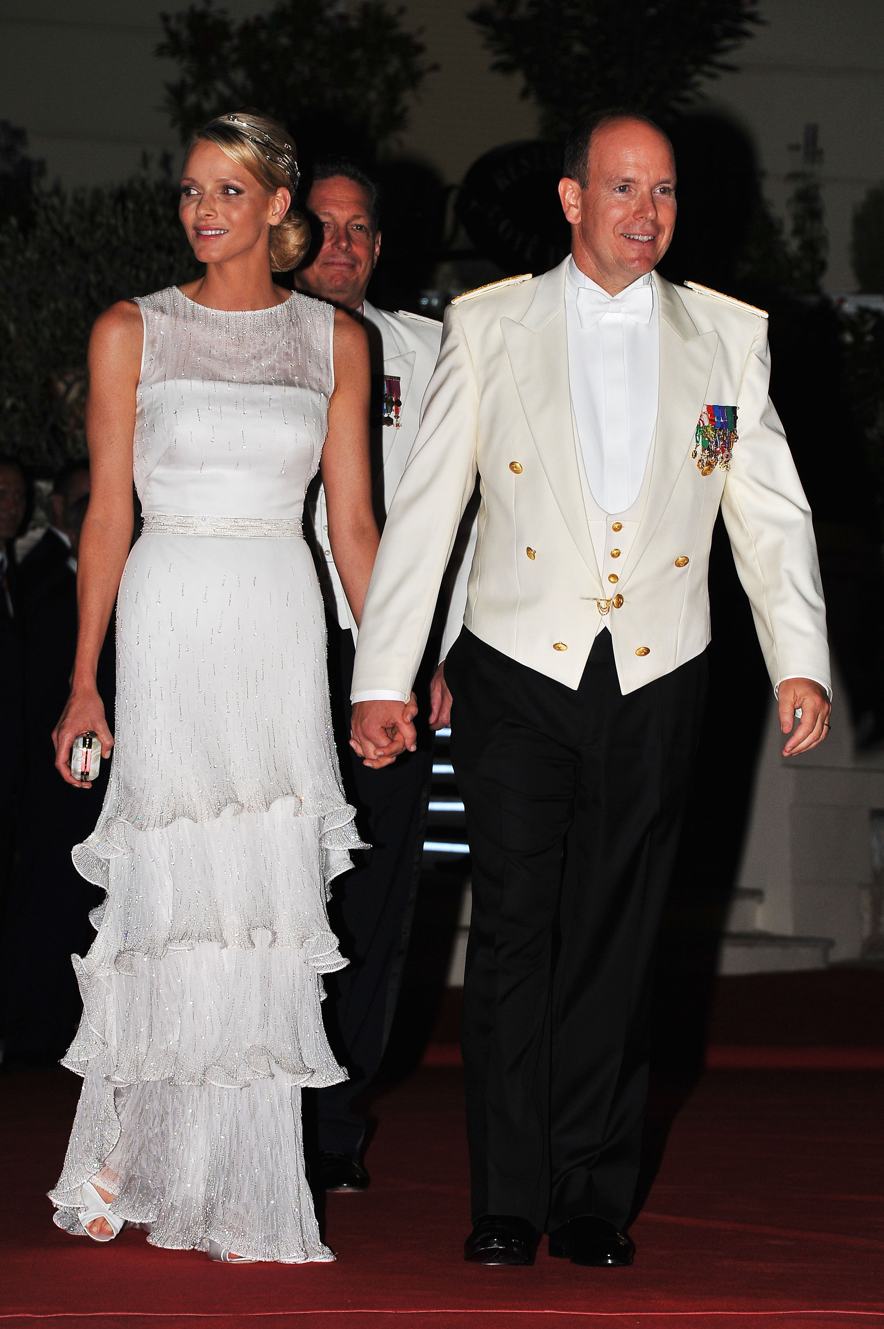 Princess Charlene of Monaco and Prince Albert celebrating their wedding day.
