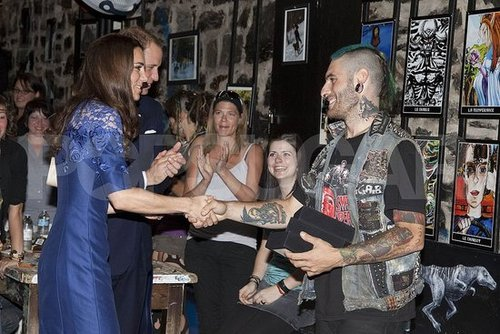 Kate Middleton shook hands with a tattooed spokesperson.