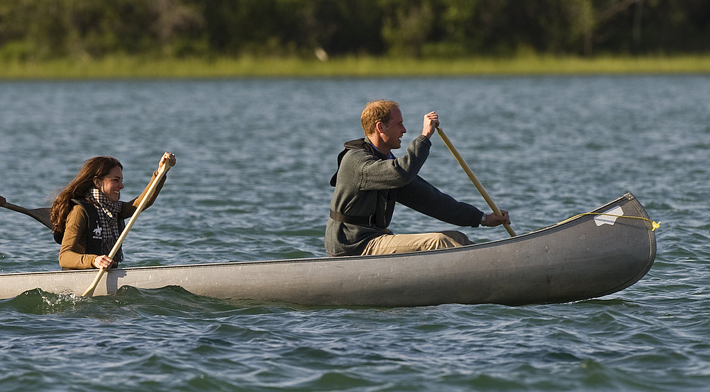 Prince William sat in front of the canoe with Kate Middleton.