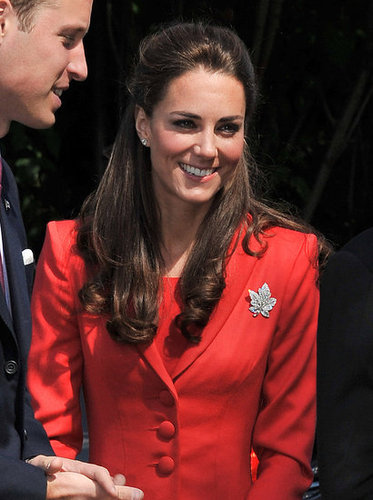 Kate Middleton flashed a smile in her red suit.