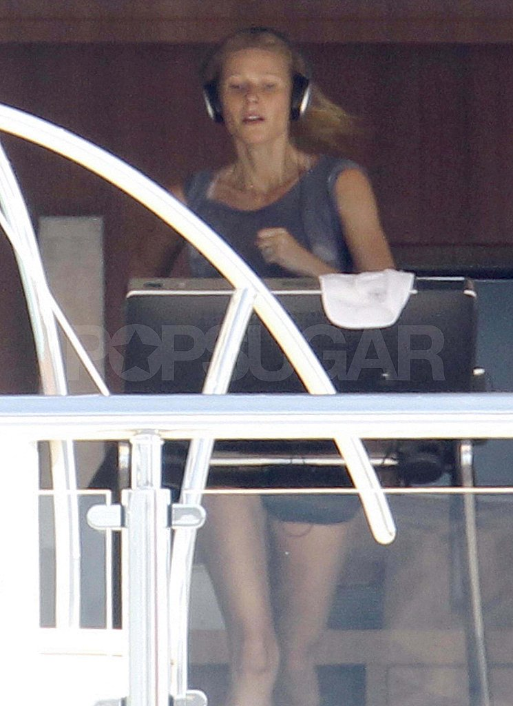 Gwyneth Paltrow running on a treadmill on a yacht.