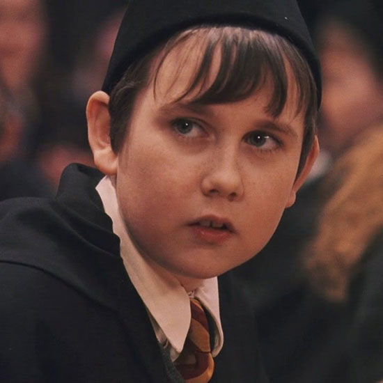 Matthew Lewis said he wore a fat suit, fake teeth, and plastic to make his ears stick out in the early films. Here's Neville in all his misfit glory in Harry Potter and the Philosopher's Stone.
