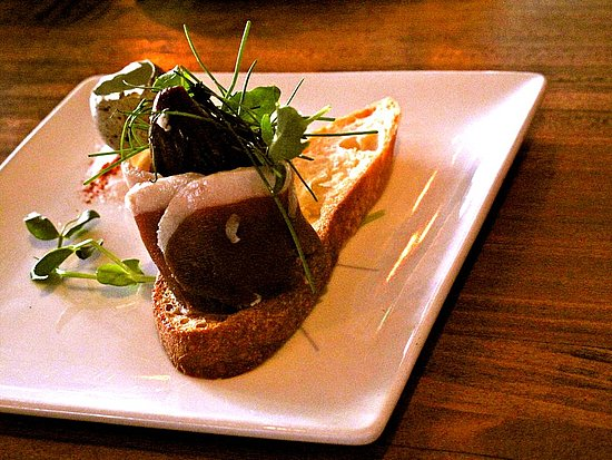 Duck prosciutto and quail egg with micro chives. A cute idea, but too fancy for my taste.