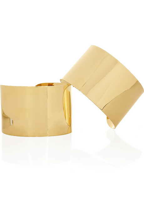 This cool pair can be worn on the arms or on the wrists.  Maison Martin Margiela Set of Two 22-karat Gold-Plated Arm Cuffs ($1,310)