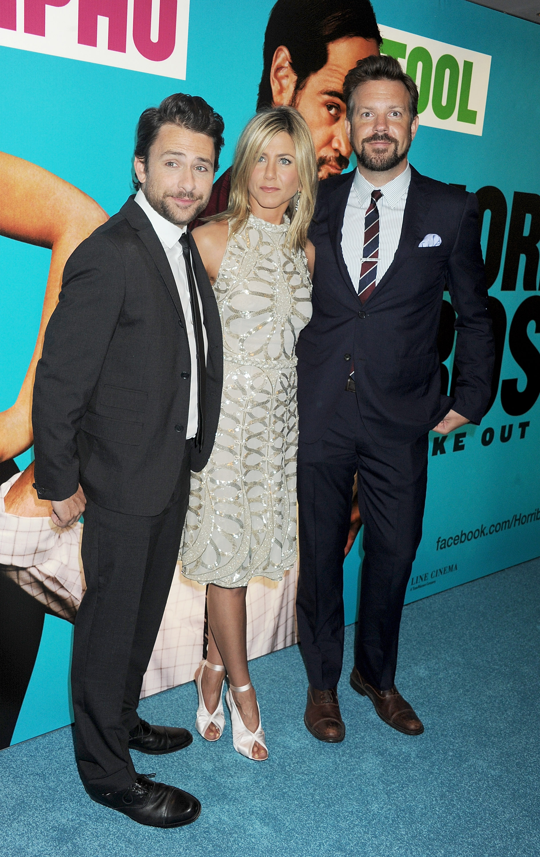 Charlie Day, Jennifer Aniston, and Jason Sudeikis pose together.