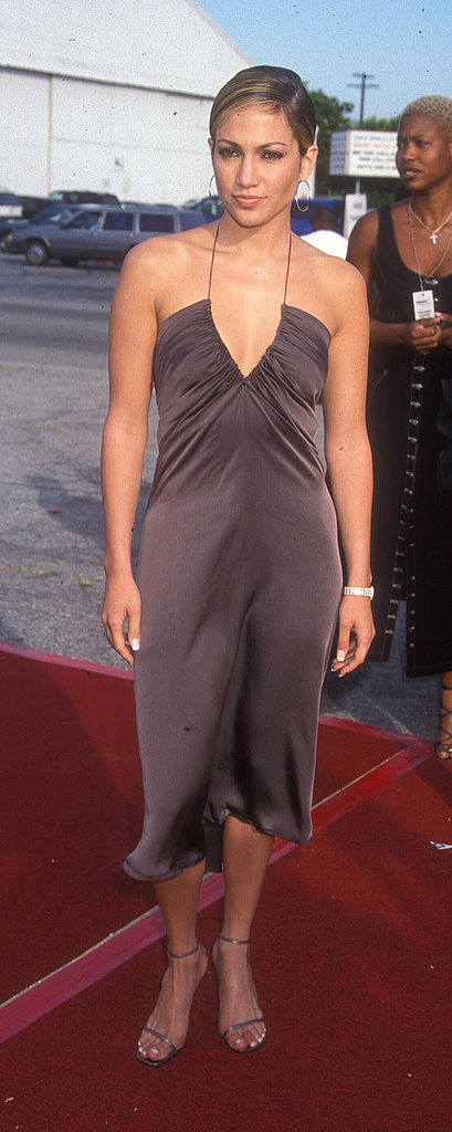 Opting for a simpler silhouette and neutral hue on the red carpet for the Teen Choice Awards in 1999.