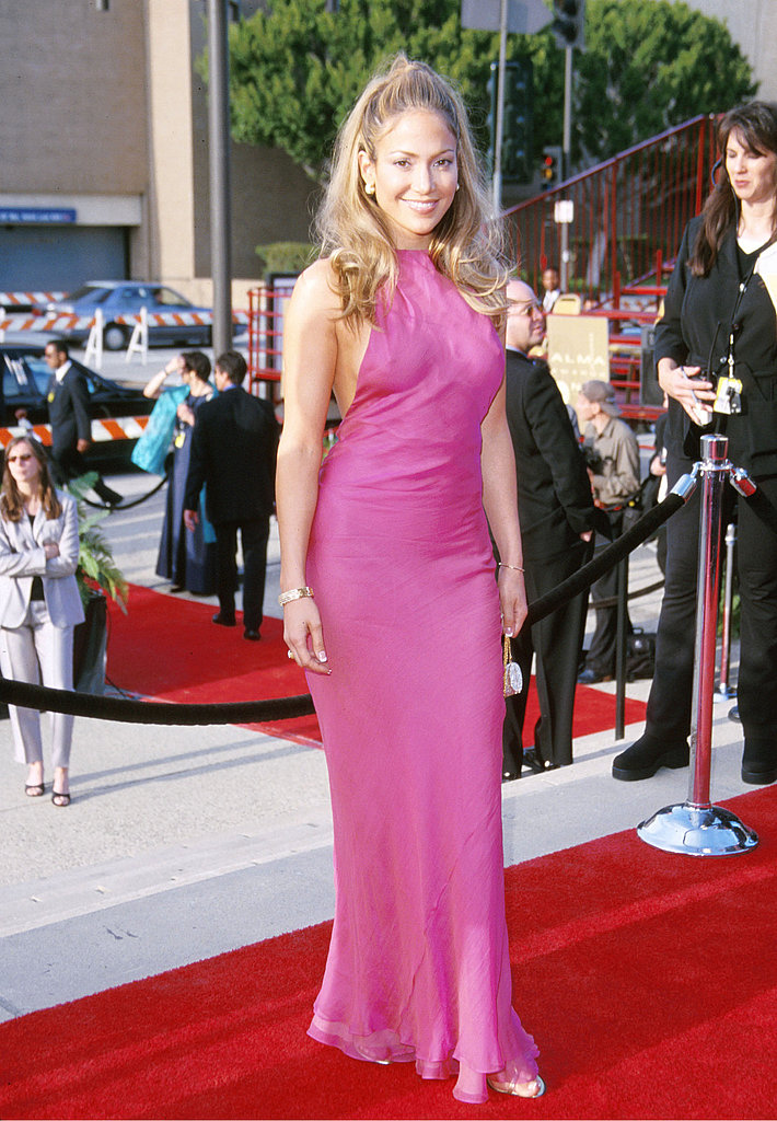 Channeling a '60s siren with Bardot-esque hair and a halter-style gown at the 2000 Alma Awards.