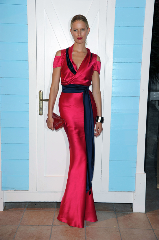Earlier this month, Karolina Kurkova attended the Ischia Global Film and Music Festival in Italy ina fuschia and navygown fromSophie Theallet's Resort 2012 collection.