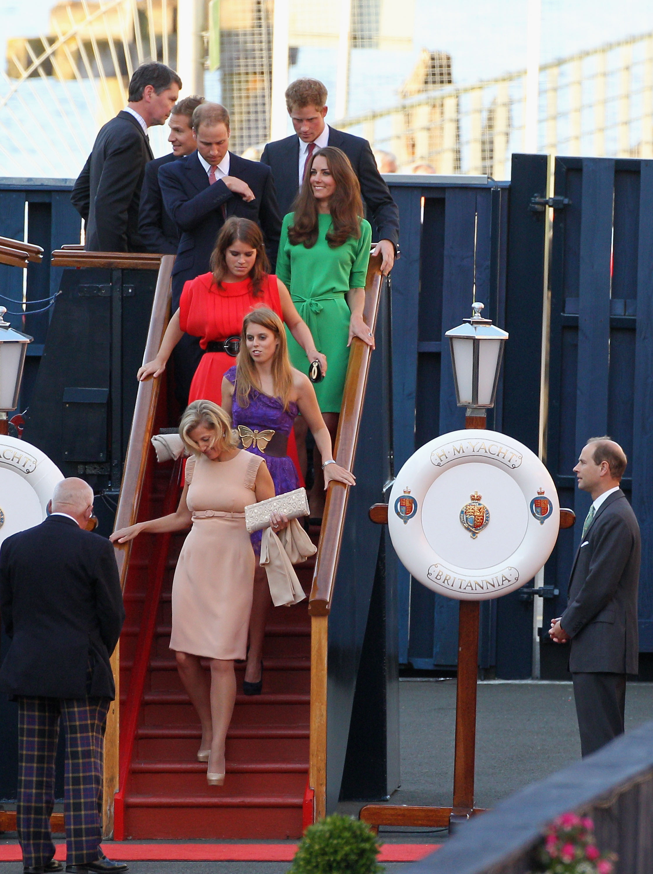 Dave Clark, Prince Harry, Prince William, Kate Middleton, Princess Eugenie, and Princess Beatrice disembark with Sophie of Wessex.