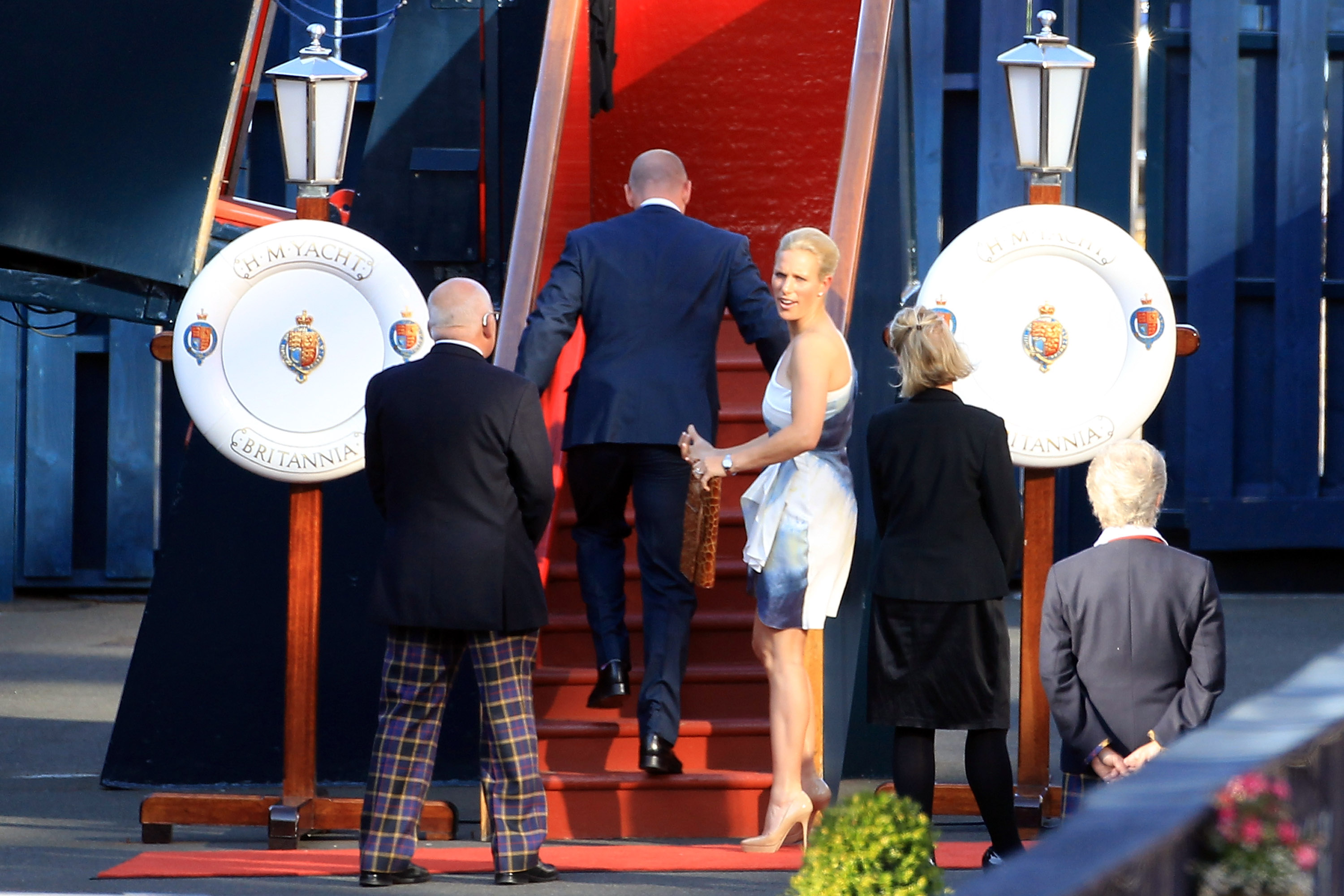Zara Phillips and Mike Tindall board the Royal Yacht Britannia.
