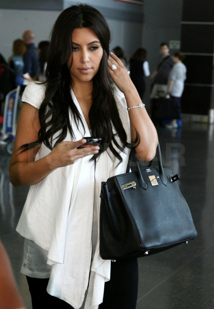 Kim Kardashian touched down in NYC after a red-eye from LA.