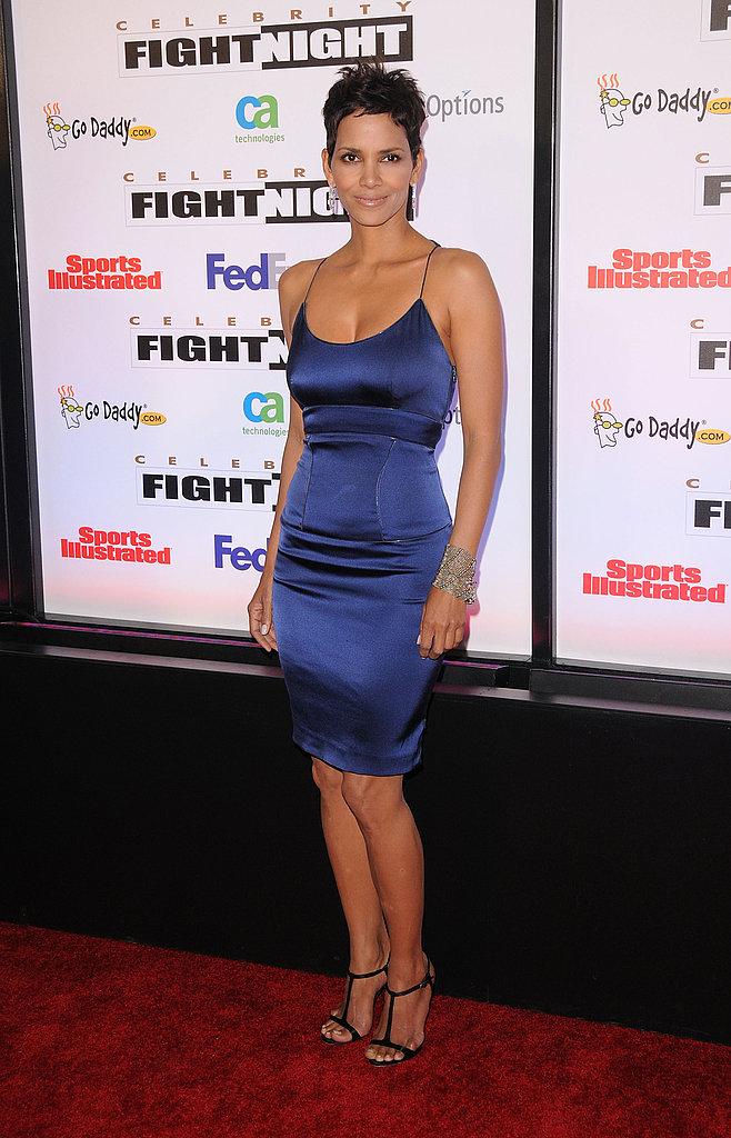 She makes this formfitting and slinky satin Rachel Roy dress look insanely good.