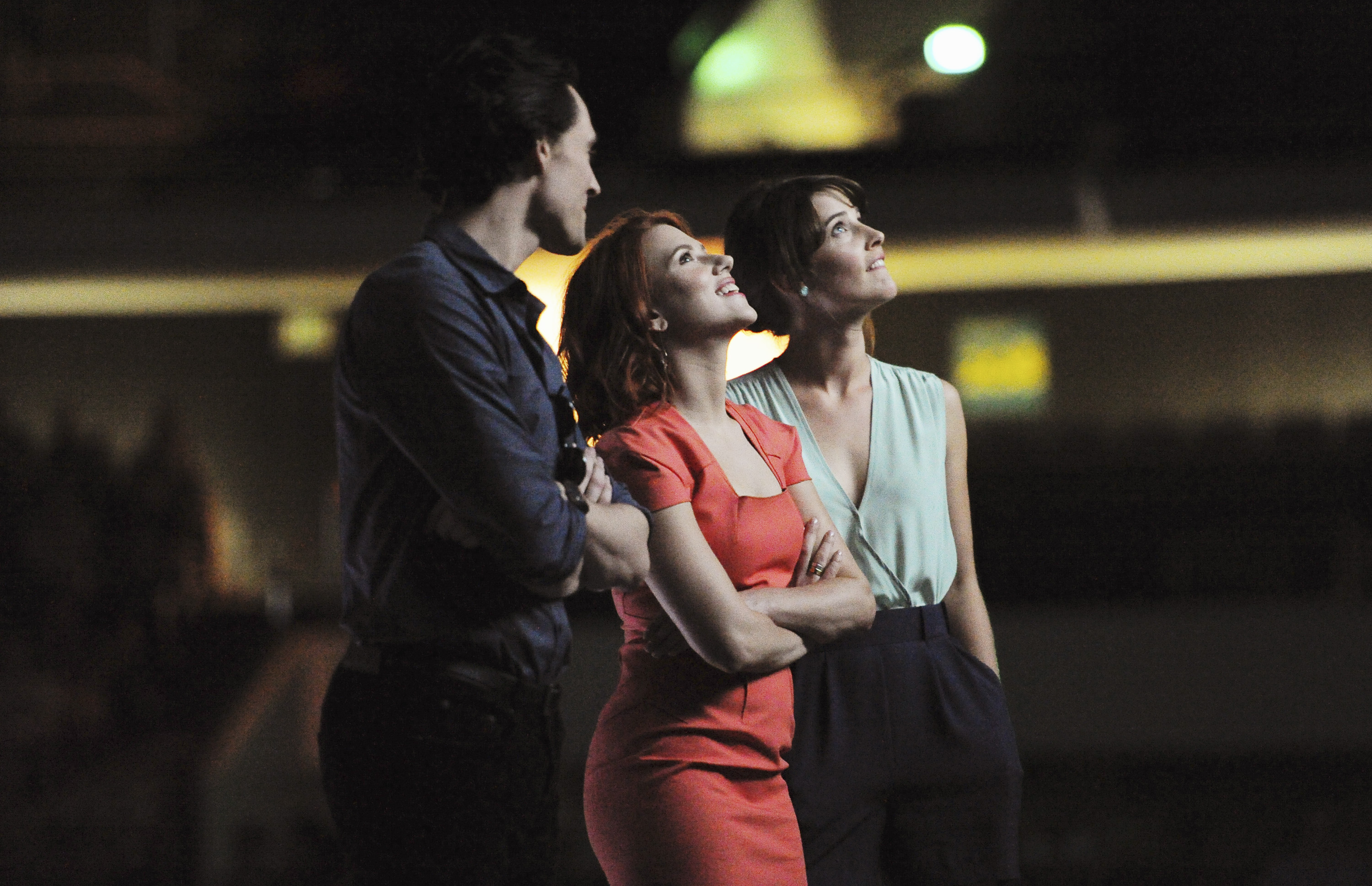 Scarlett Johansson watches a preview of The Avengers with Tom Hiddleston and Cobie Smulders.