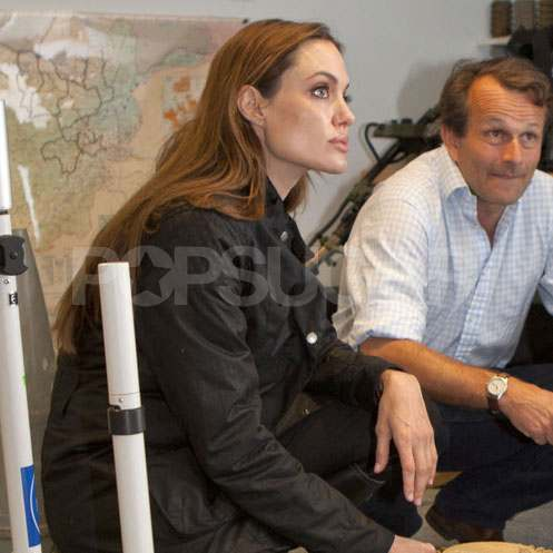 Angelina Jolie Makes a Philanthropic Stop While Brad Pitt Poses With Fans