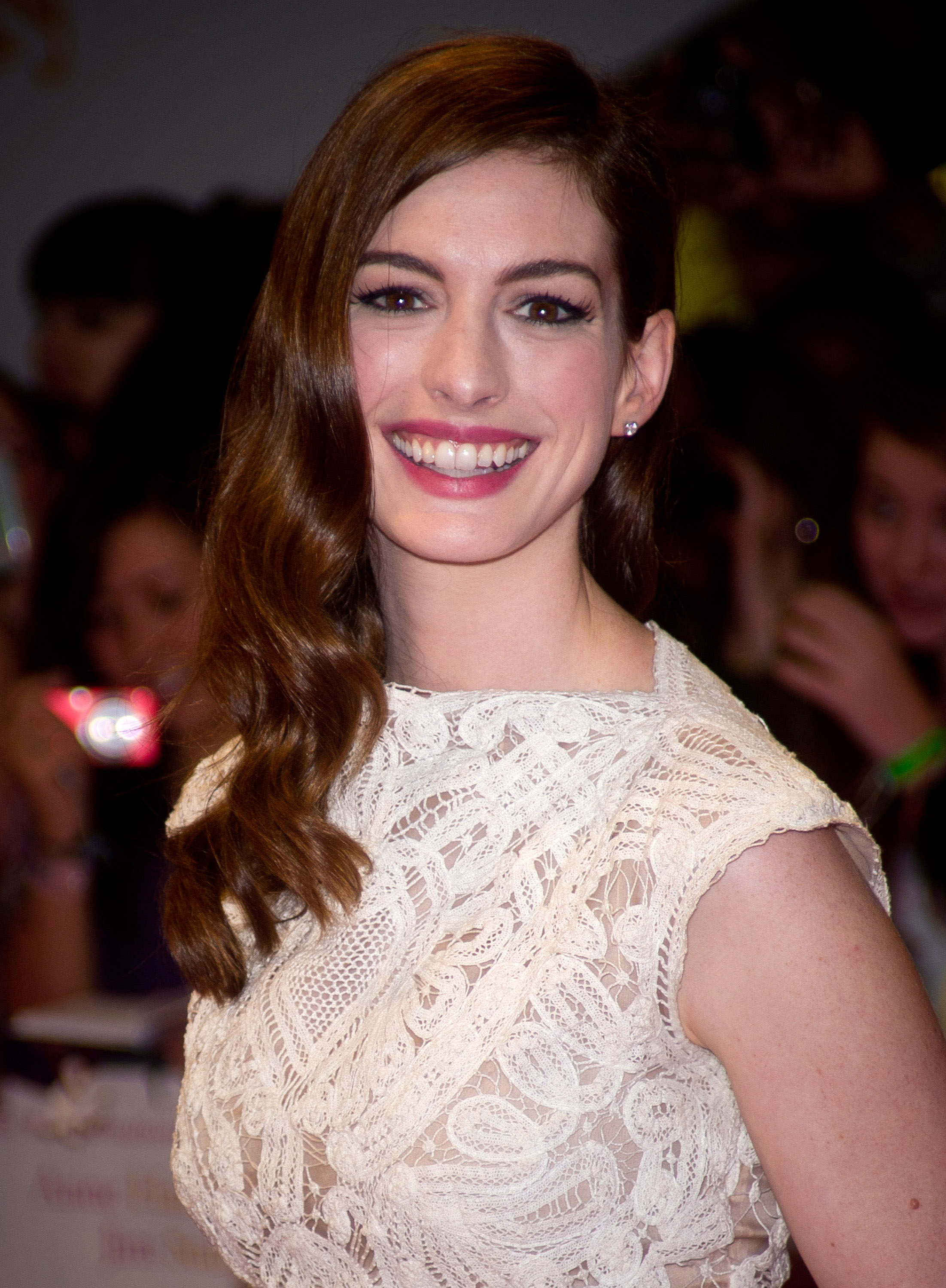 Anne Hathaway rocked red lips.