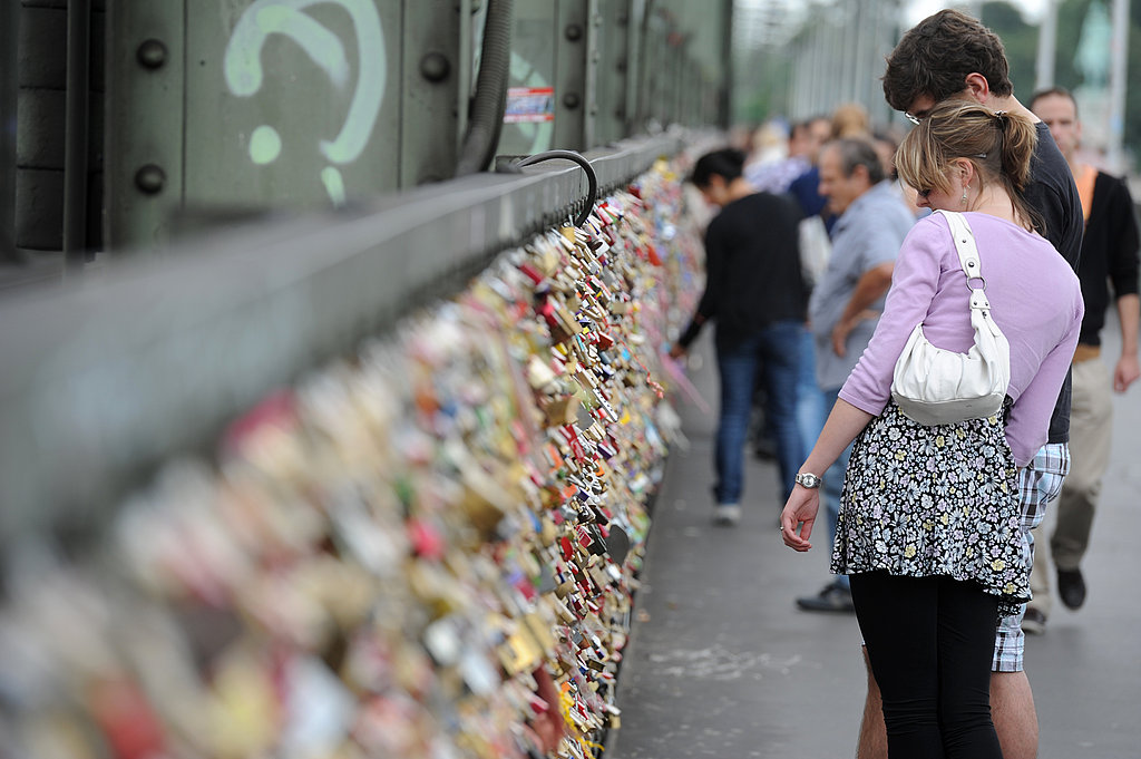 A couple looked at the love locks on Hohenzollernbruecke bridge in Cologne, Germany.
