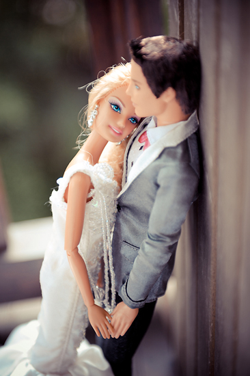 Barbie and Ken get close. Photo by BdG Photography via Rock n Roll Bride