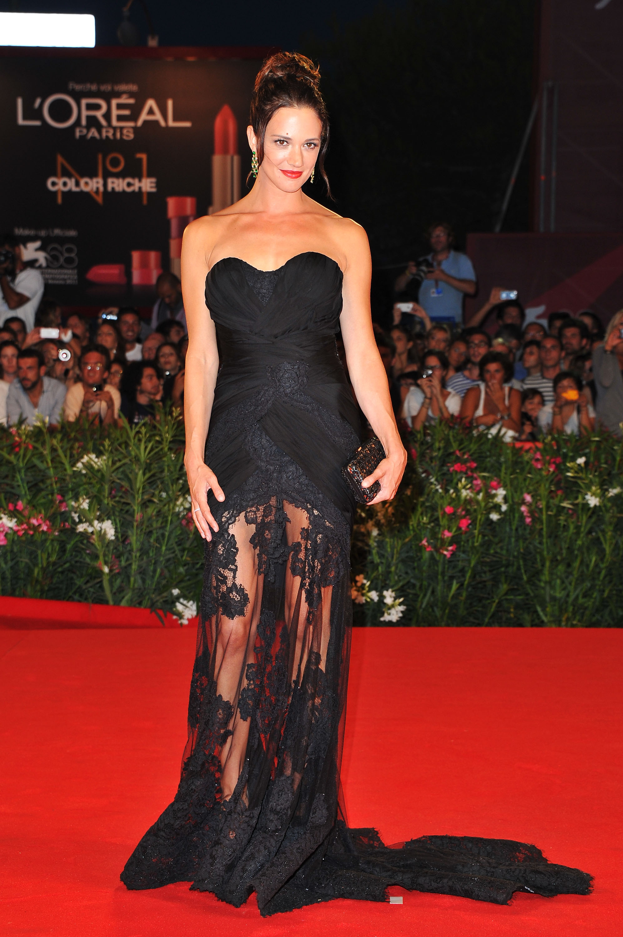 Asia Argento wore a sheer lace gown by Alberta Ferretti.