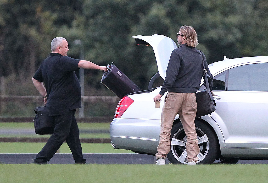 Brad Pitt gets picked up by a car.