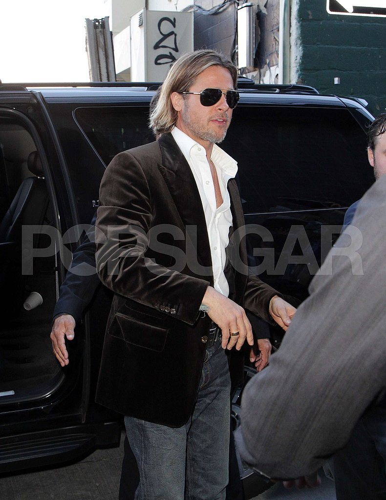 Brad Pitt arrived for his Moneyball press conference.
