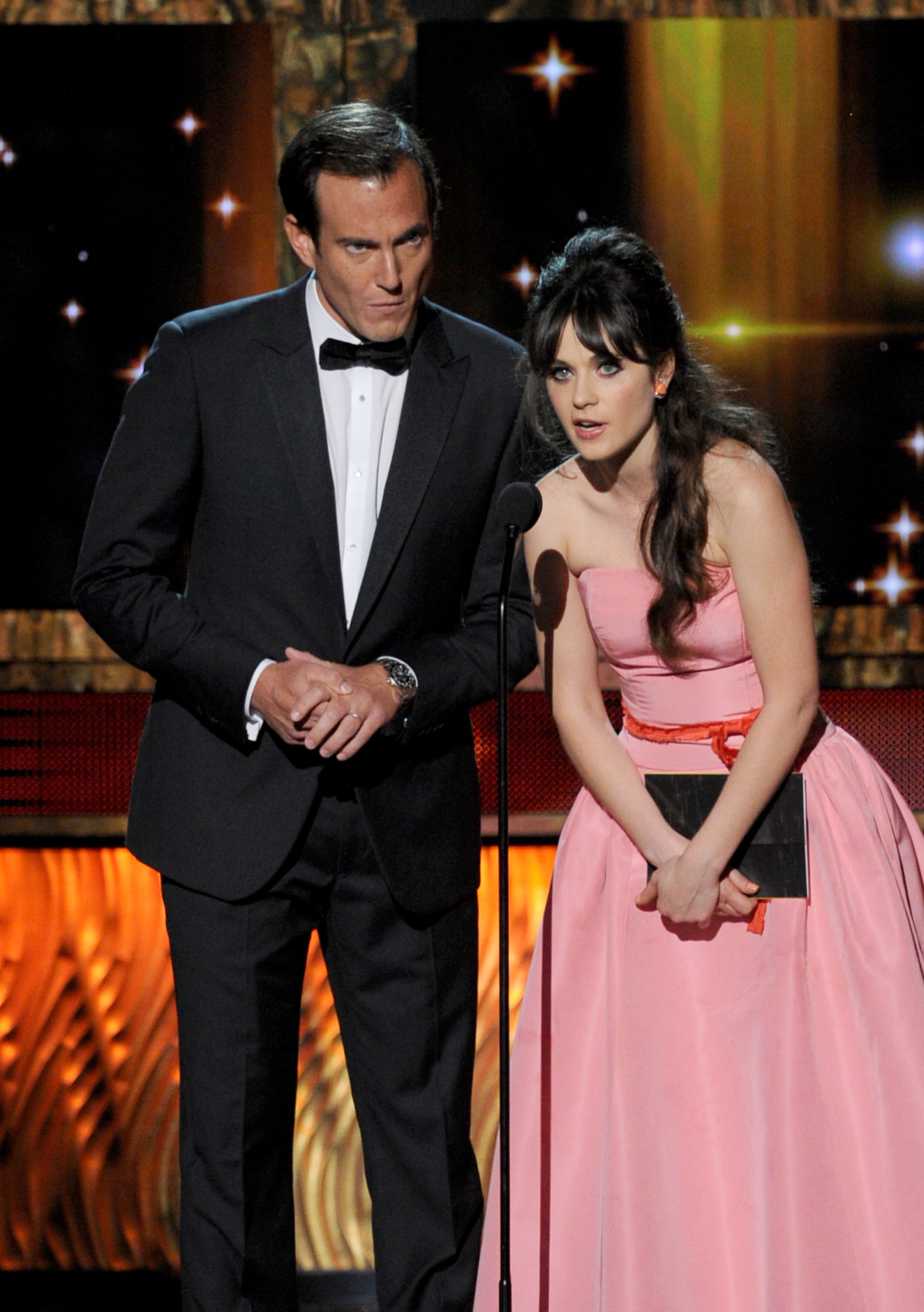 Will Arnett and Zooey Deschanel were presenters at the 2011 Emmy Awards.