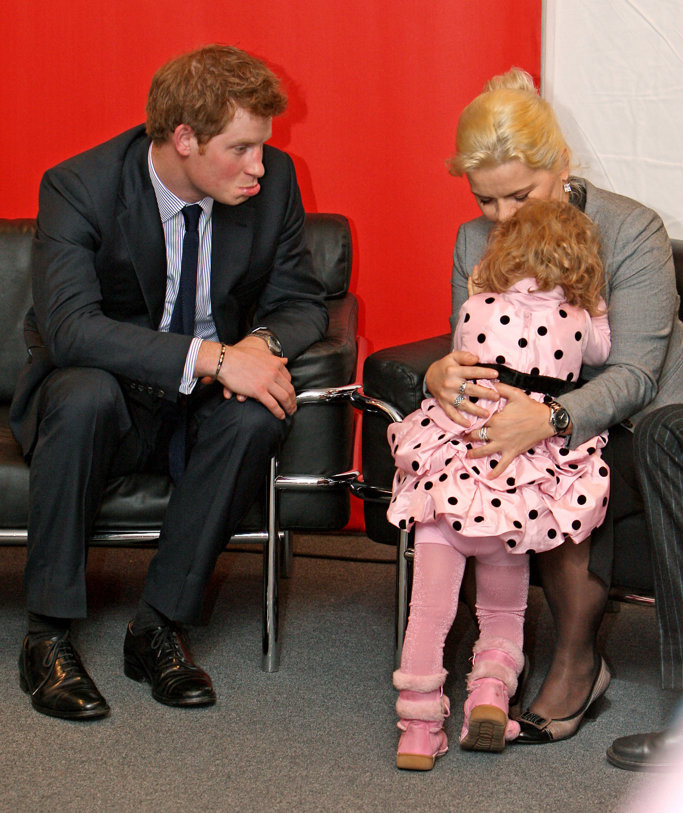 Prince Harry Makes A Pouty Face At A Little Girl During A
