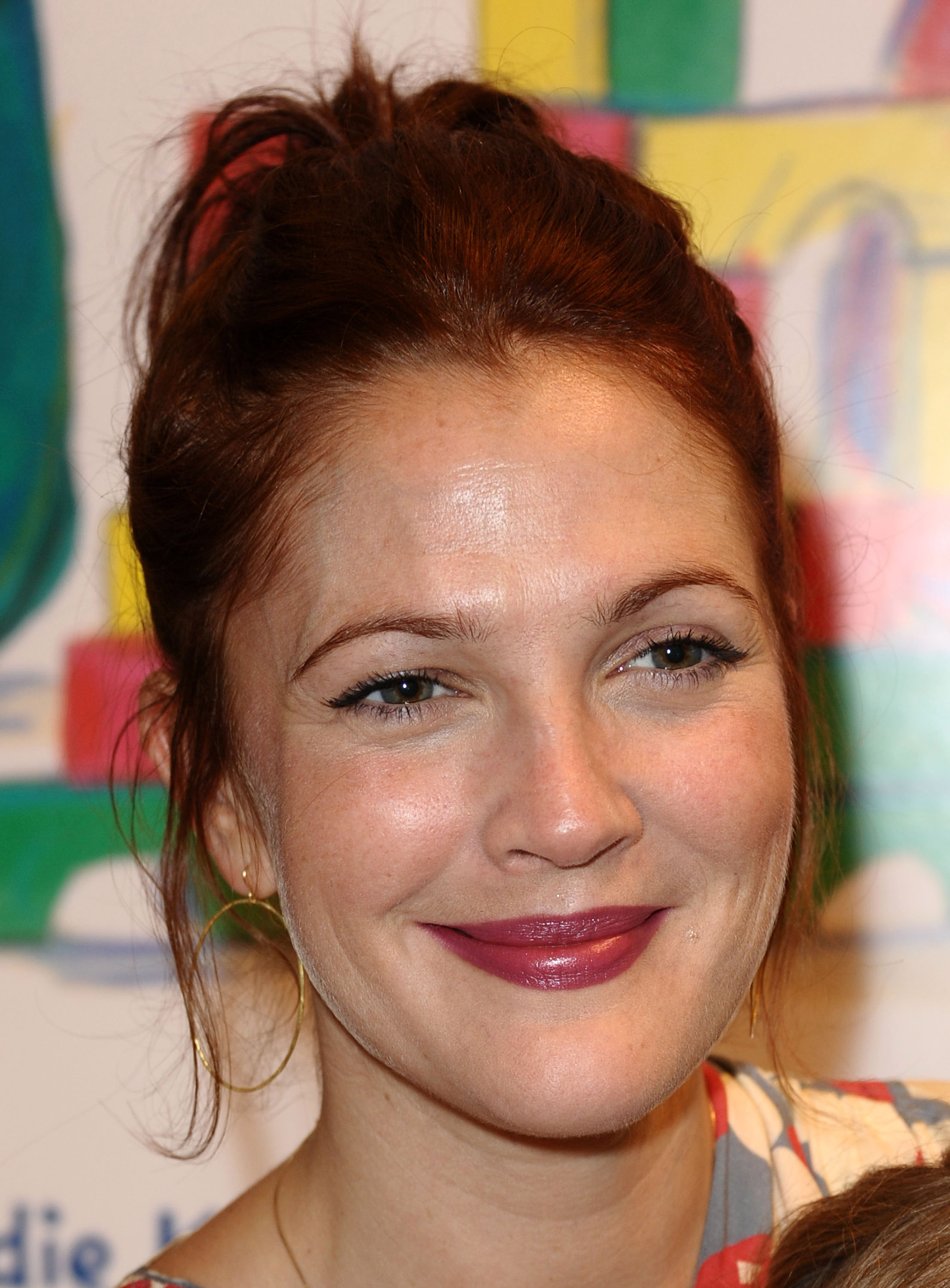 Drew Barrymore wore her red hair pulled back.