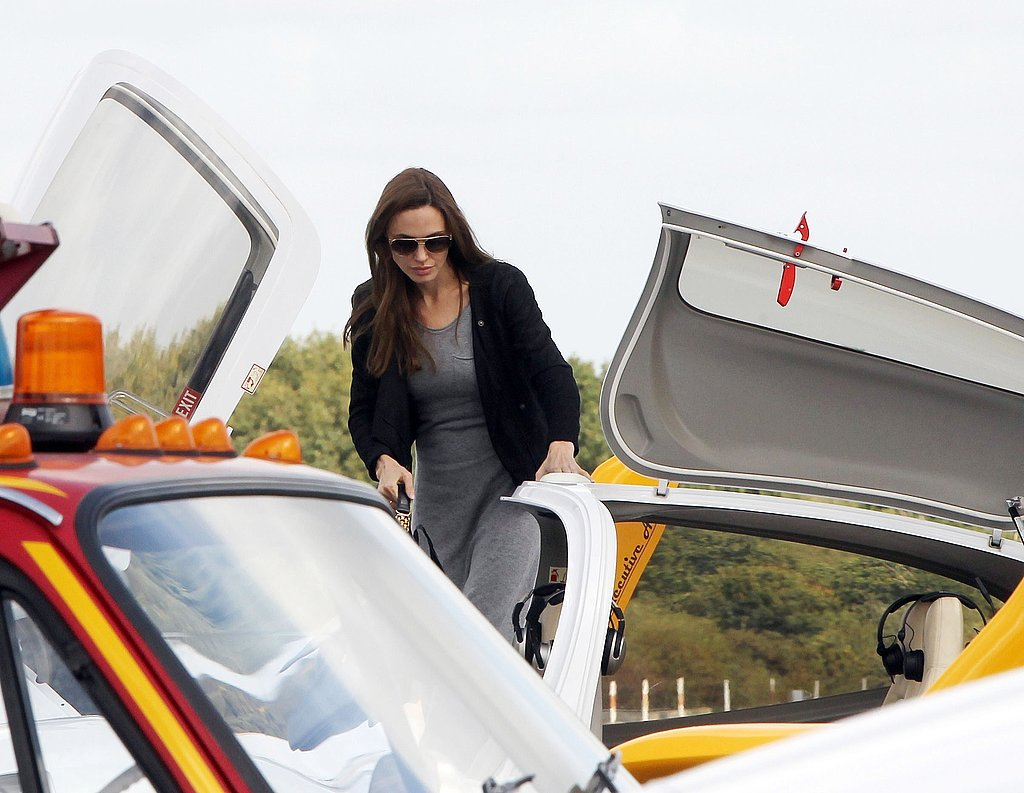 Angelina Jolie boards a small plane.